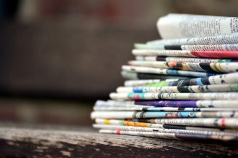 Newspaper stack image by congerdesign from Pixabay